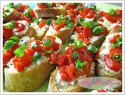 Baguette Slices Topped With Goat Cheese & Sweet Roasted Peppers